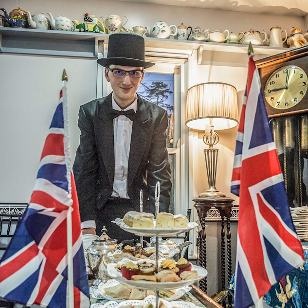 Waiter serving high tea at Bygone Beautys
